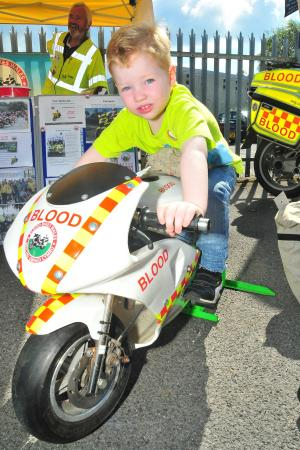 South Wales Guardian: Four year old Sam Lewis finds his perfect ride on the Blood Bikes Wales stand at Llandeilo Fire Station Open Day.  Picture by Mark Davies